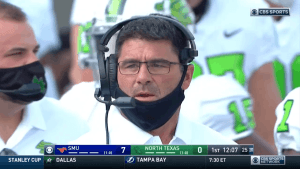 Seth Littrell wearing a mask improperly
