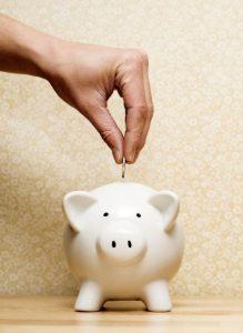 Saving into a piggy bank