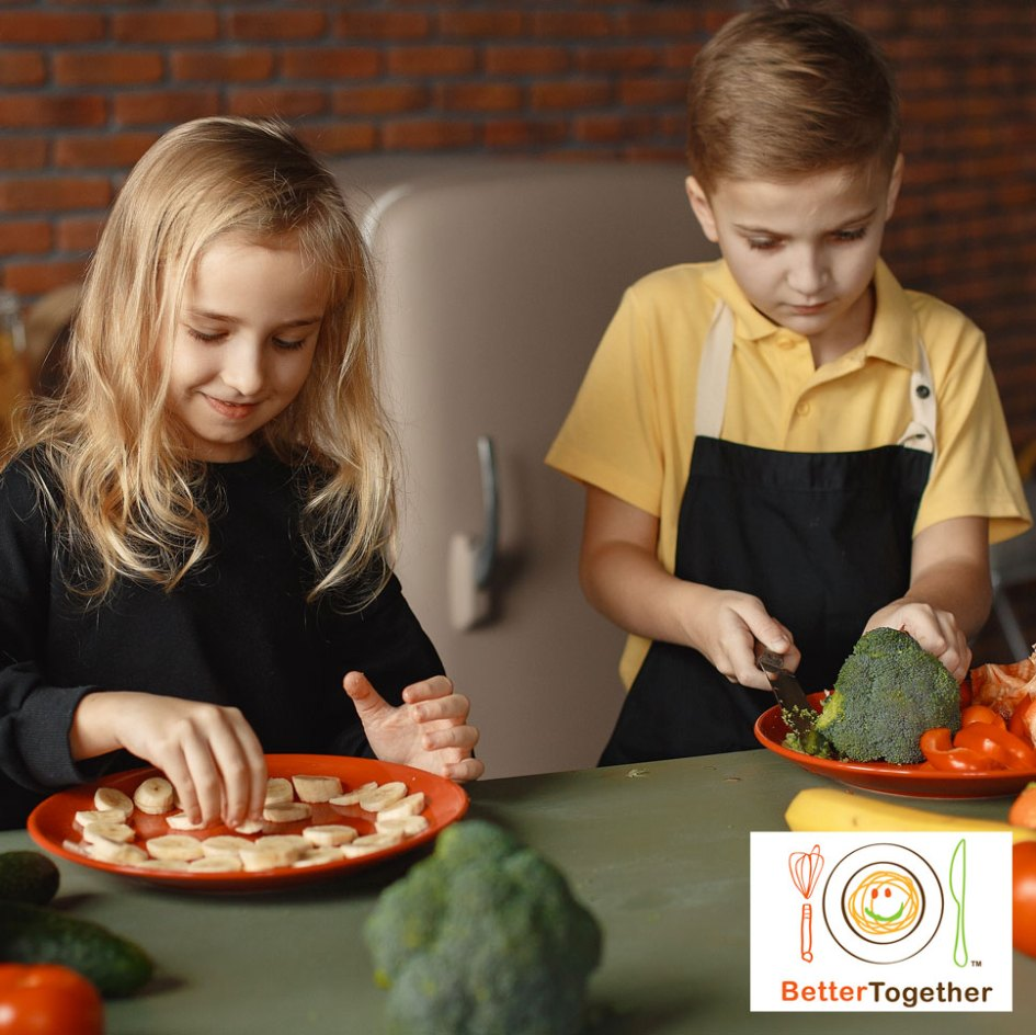 kids cooking and cutting vegetables in kitchen