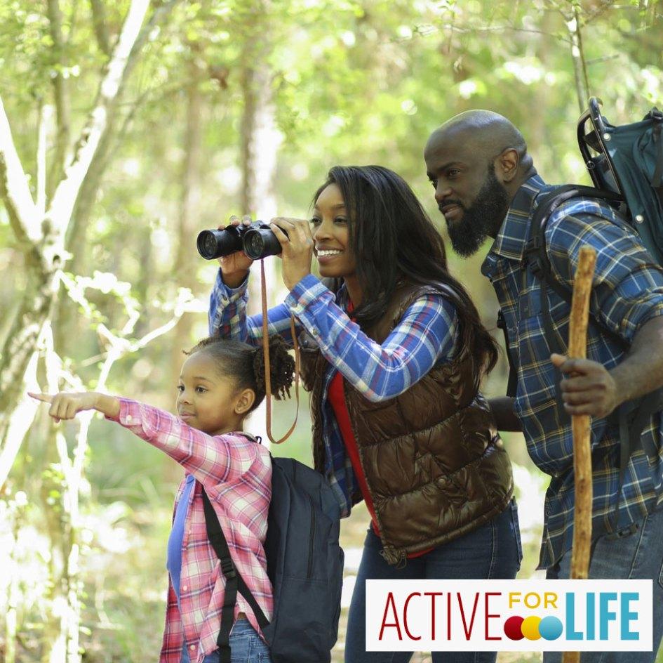 family on hike looking through binochulars