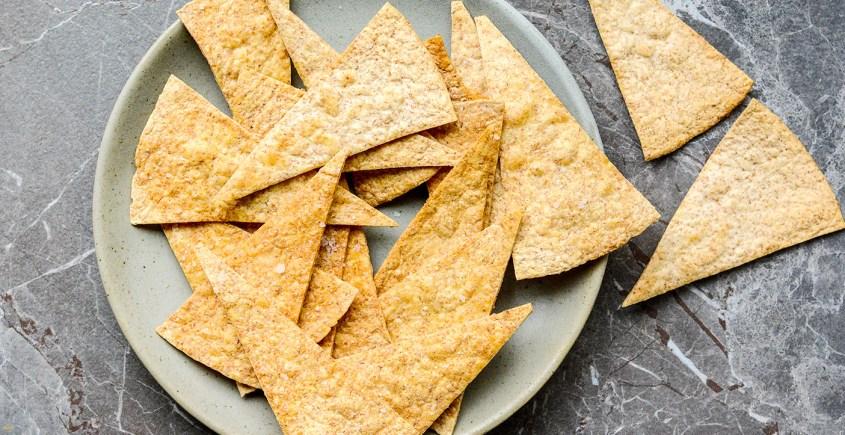 baked pita crisps on plate
