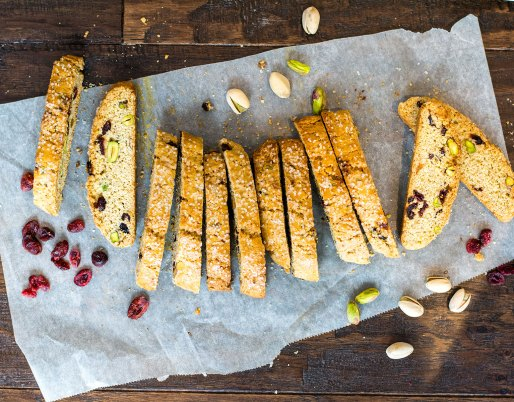 biscotti cookies on a wooden background with cranberries and pistachios