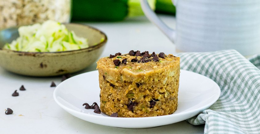 image of muffin with zucchini on white plate