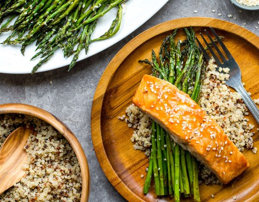 baked salmon on wooden plate with asparagus
