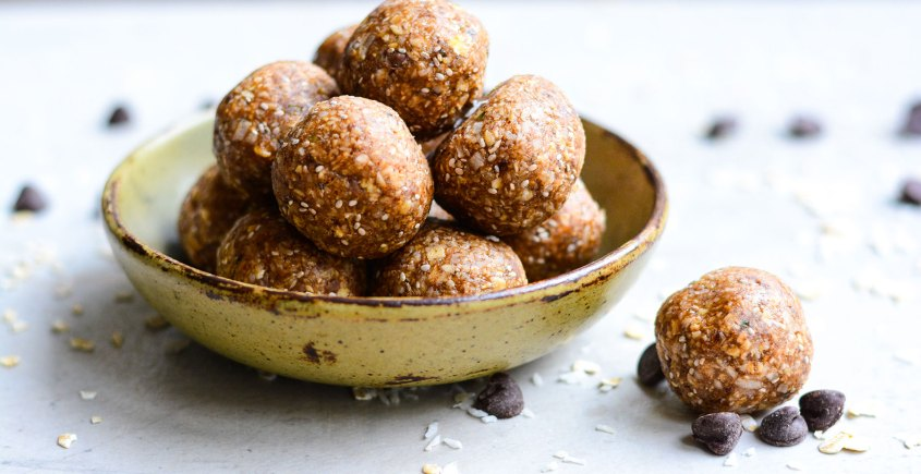 side view of cookie dough energy bites in a bowl