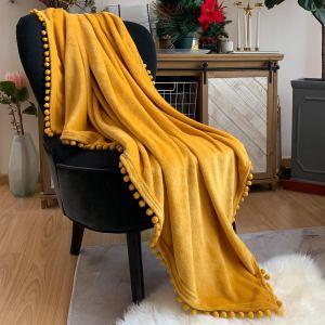 flannel-blanket-with-pom-pom-fringe