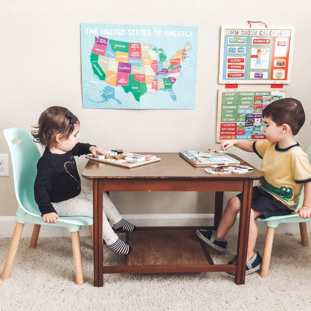 how-to-homeschool-preschool-the-laid-back-way-concept-2 kids-in-chairs-sitting-at-a-table-working-on-puzzles