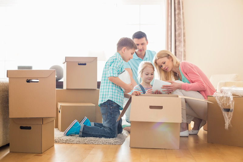 moving-checklist-concept-family-unpacking-boxes-at-new-home