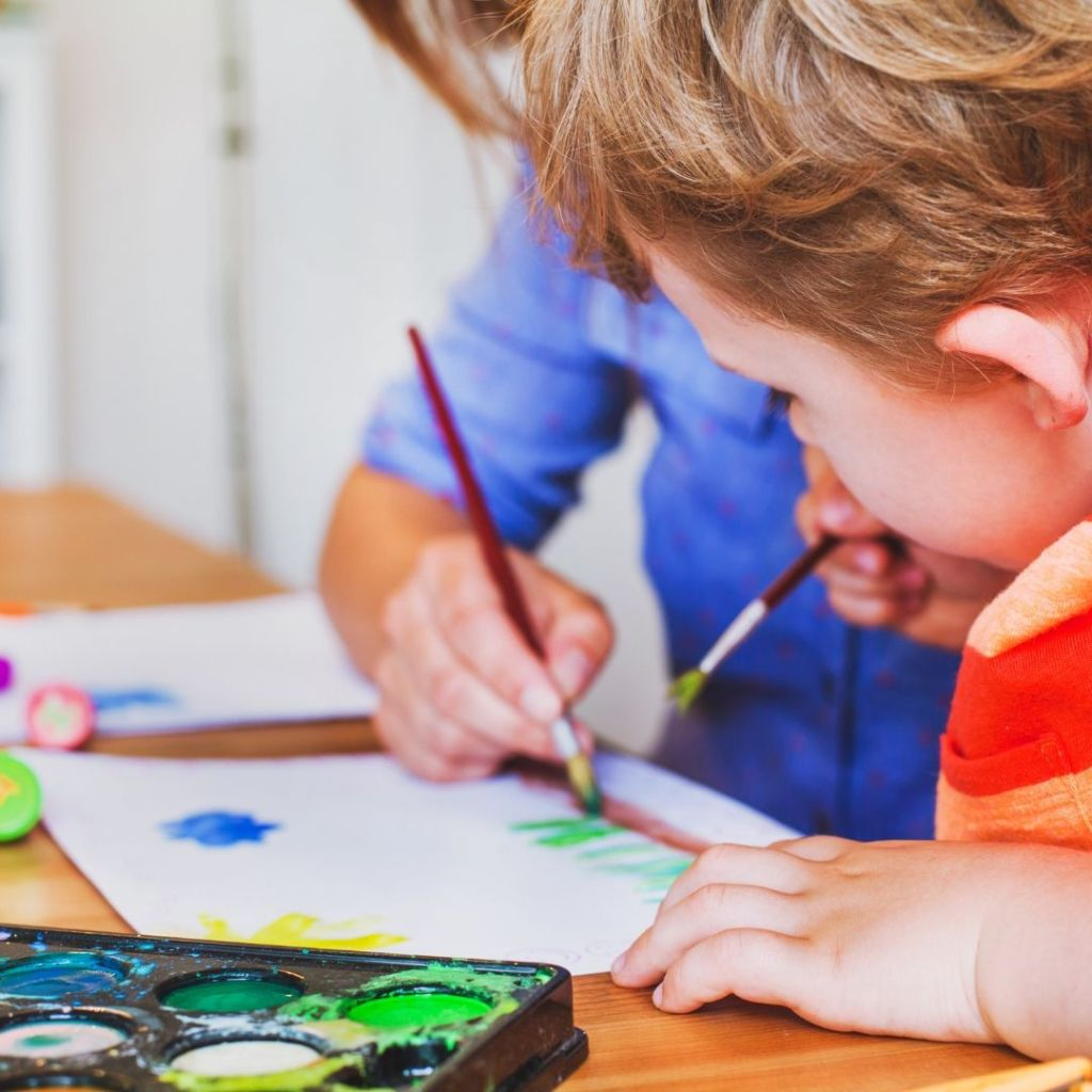 free-activities-for-kids-concept-two-kids-painting-at-home