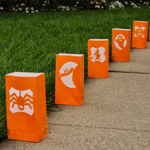 orange bag luminaries lined up along sidewalk