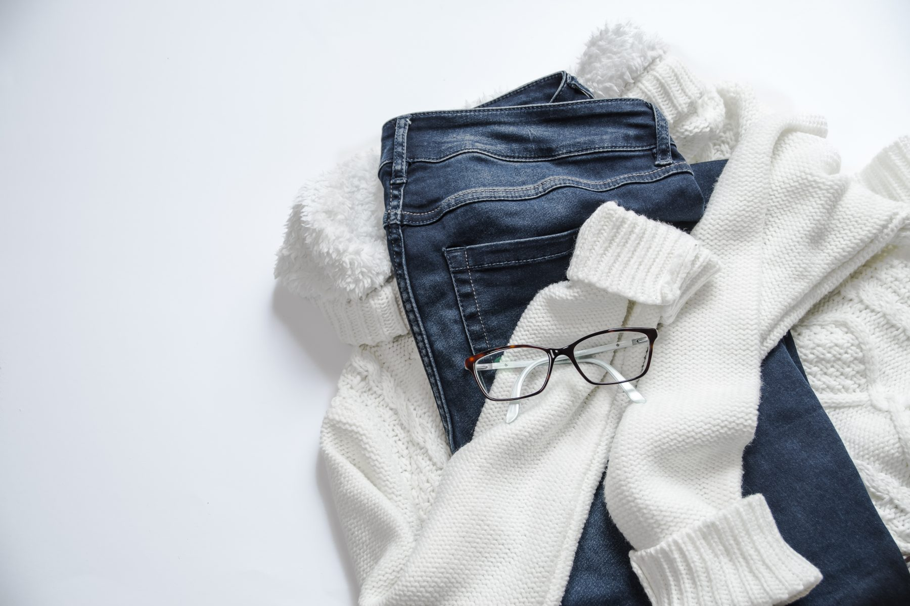 black-framed-eyeglasses-white-jacket-and-blue-denim-jeans