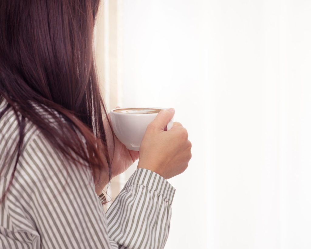 woman-holding-cup-of-coffee