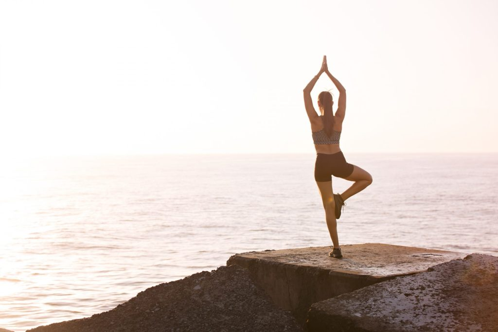 woman-meditating-on-rock