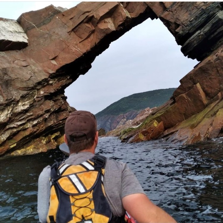 Kayaking to the Arch in Meat Cove