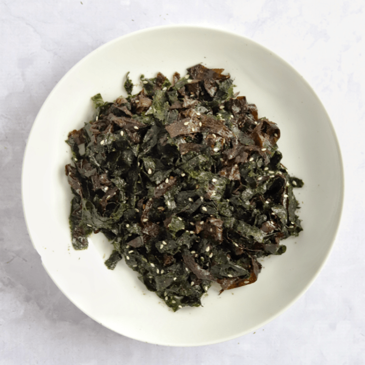 a bowl of nori seaweed salad
