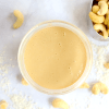 ingredients for making keto nut butter - macadamia nuts, coconut and cashews