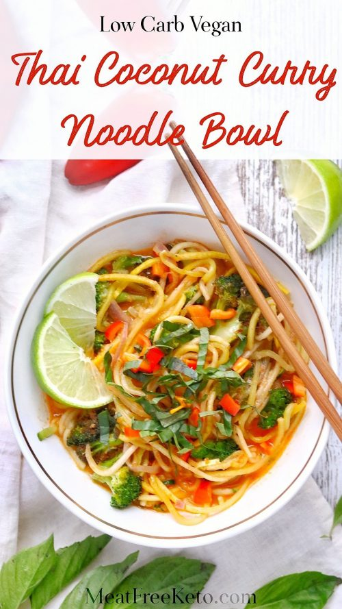 a bowl of thai curry zucchini noodles with lime slices and chopsticks