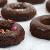 Vegan Keto Chocolate Doughnuts | MeatFreeKeto.com - These delicious doughnuts are easy to throw together and so darn tasty! They're also gluten-free, nut-free, soy-free, coconut-free, egg-free and dairy-free. Not bad for a low carb treat!