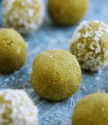 lots of matcha protein bites, some with coconut flakes on the outside