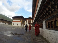 A monk at the prayer wheels
