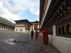 A monk at the prayer wheels