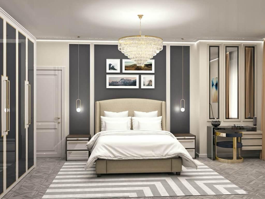 большая спальня изобилует авторской мебелью распашным шкафом с латунью и тумбой в шпоне
