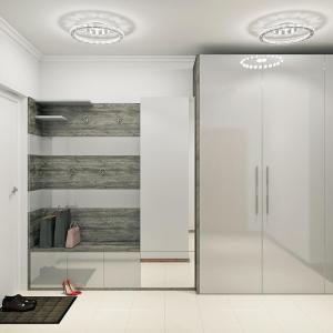 просторная прихожая в светло серых оттенках с фасадами мдф эмаль глянец