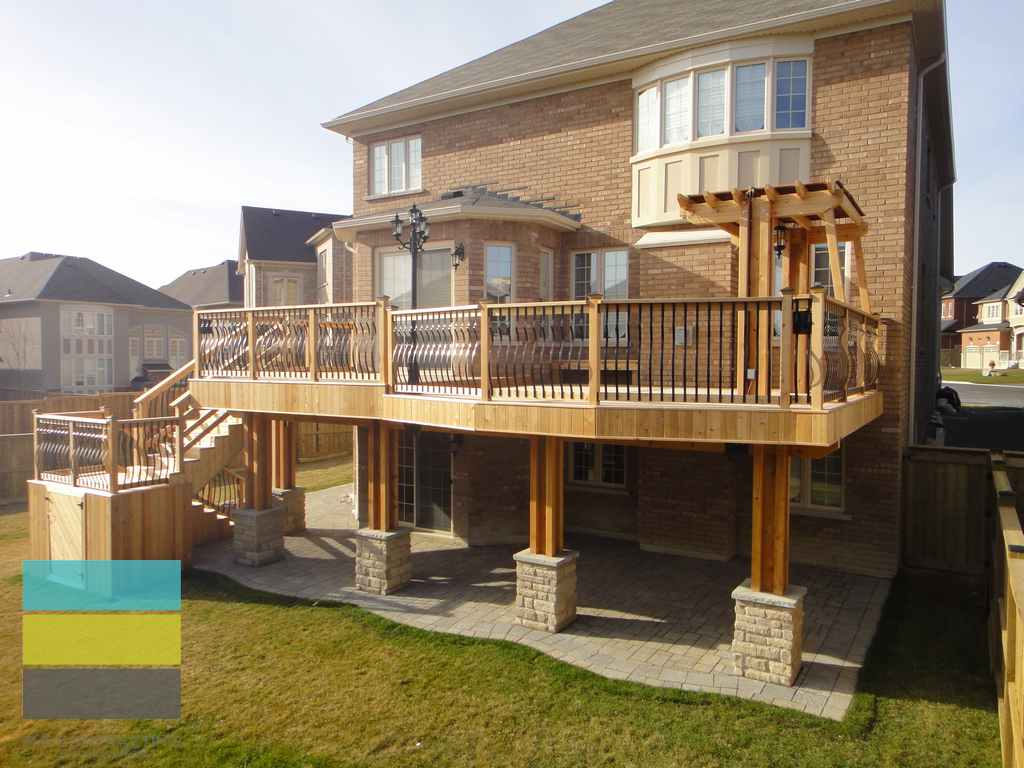 2 Level Cedar Deck With Wrought Iron Railings Pergola And