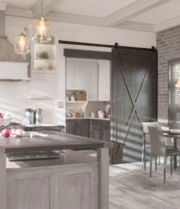 Blending the epitome of Farmhouse style with an X-pattern on a sliding barn-door!