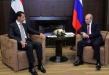 Presiden Suriah Bashar al-Assad bertemu dengan Presiden Rusia Vladimir Putin di kota Sochi, Senin (20/11/2017).(Mikhail KLIMENTYEV / SPUTNIK / AFP)
