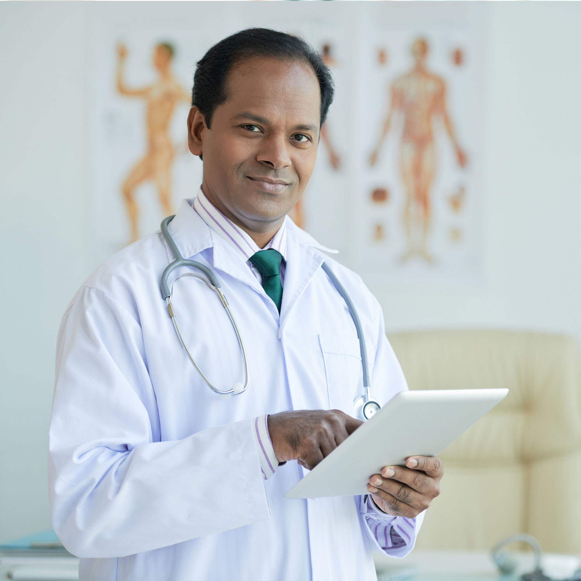 A doctor using the MedekRPM portal to monitor patients and reimbursement from anywhere