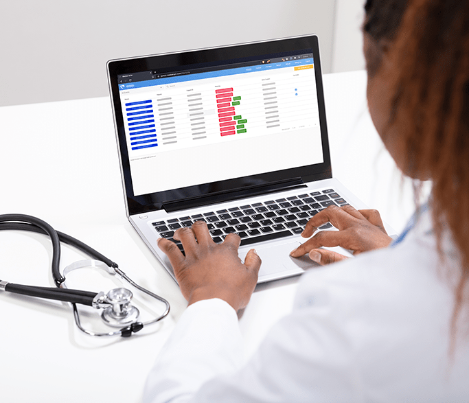 A doctor using MedekRPM Remote patient monitoring portal to provide care to patients