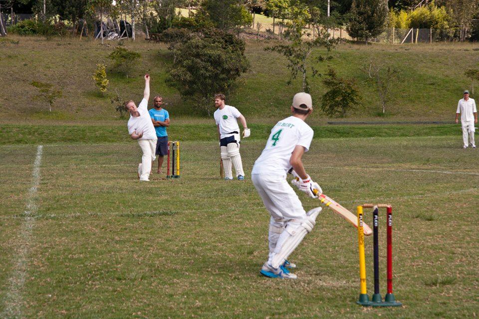 A bowler bowling against a batsman