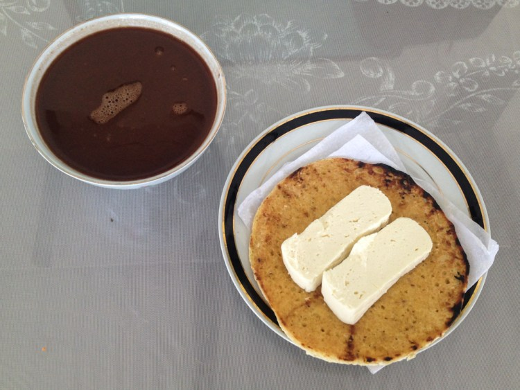 Arepa with cheese and hot chocolate