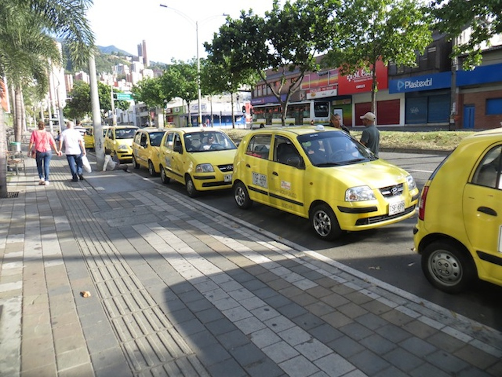 Taxis in front of Premium Plaza mall