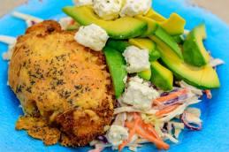 Saturday dinner. Cheesy Chicken Kiev with celeriac slaw plus avocado and feta cheese.
