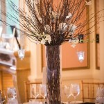 Tall Centerpieces With Branches And White Flowers