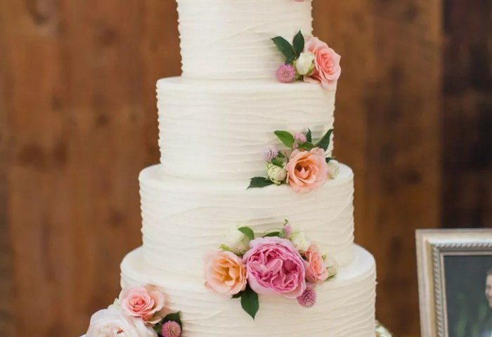 White Wedding Cake With Piping And Fresh Roses