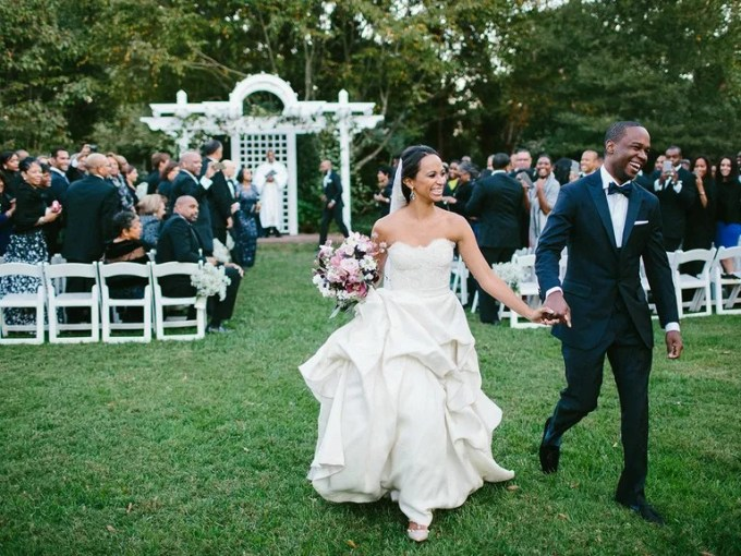 The National Average Cost of a Wedding Is  35 329 Bride and groom exiting their outdoor wedding ceremony