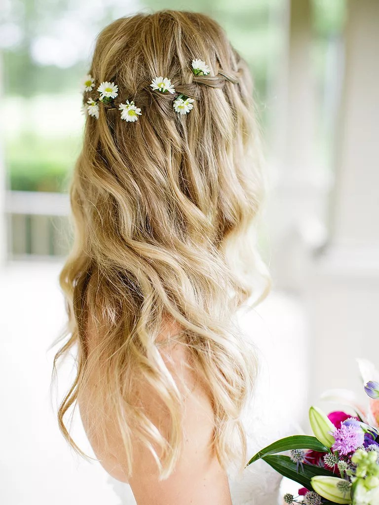 loose waves wedding hairstyle with flowers