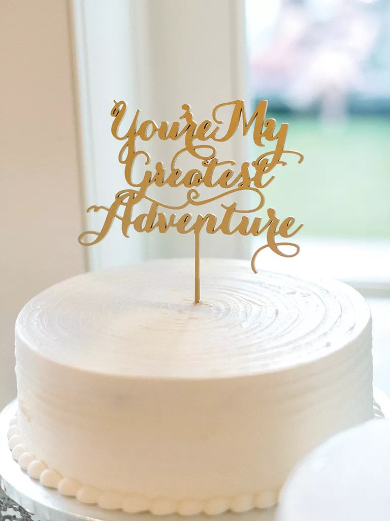 Simple and Unique Wedding Cake Inspiration Simple single tier wedding cake with calligraphed cake topper