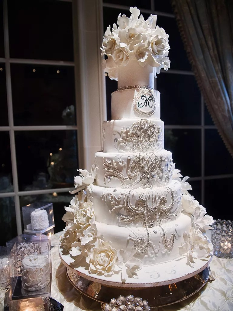 18 Wedding Cakes With Bling That Steal the Show Tall white wedding cake with ornate crystal design