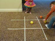 masking tape indoor games -hopscotch, bulls-eye bowling, tic-tac-toe, guard the eggs, long jump, balance beam