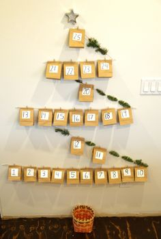 This is exactly how we did our advent calendar this year only we used yarn and also using it as the jesse tree when we pull a bag off we put up the jesse tree ornament