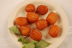 Iranian Bamieh is an oval-shaped piece of sweet dough, deep-fried, and then covered with a syrup traditionally made with honey. Bamieh is similar to tulumba, but much smaller, 2 or 3 centimeters wide at most.