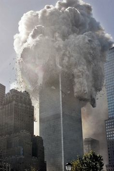 The north tower of New York's World Trade Center collapses after being struck by hijacked American Airlines Flt. 11, Tuesday, Sept. 11, 2001.
