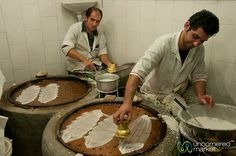 """Iranian men making Gol Reshte at the Rasht market. This is an Iranian dessert made from rice flour pancake filled with cinnamon, sugar and walnuts. We ate them raw, but you're supposed to fry them with honey or sugar water."""