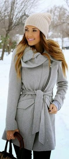 love her hat and coat together! she has a winter glow!