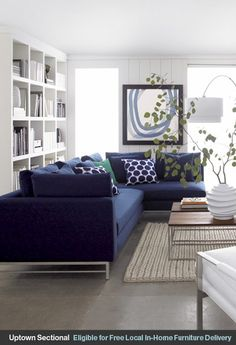 Love the navy blue and aqua  Nice colors to go with my Navy couches