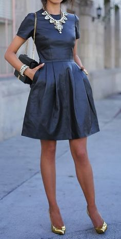 love this leather dress + bold statement necklace
